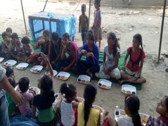 Serving Meal to slum children's_3