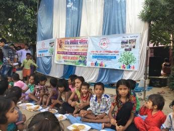 Serving Meal to slum children's_6