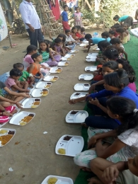 Serving Meal to slum children's_8