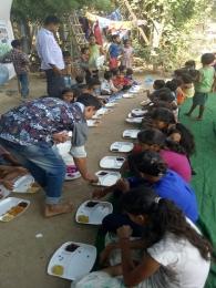 Serving Meal to slum children's_9